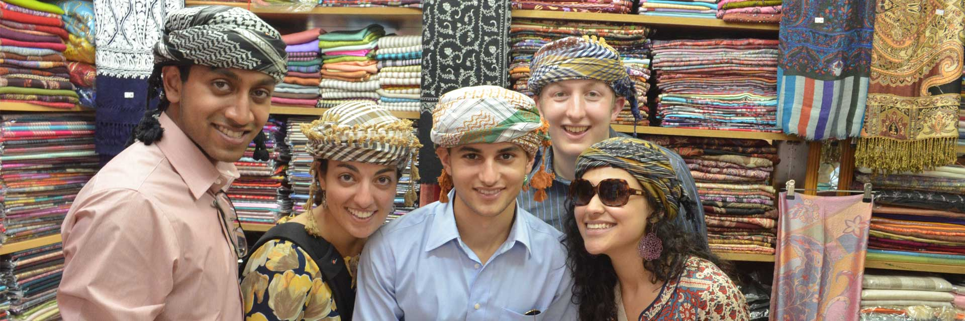 2013-Alumni-Trying-on-Turbans-in-Souq-Mutrah-Muscat-Oman